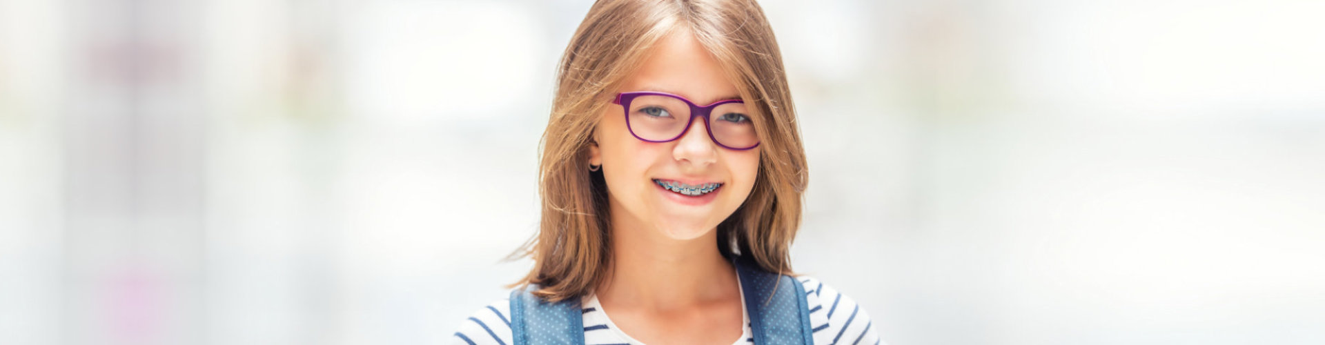 female kid smiling